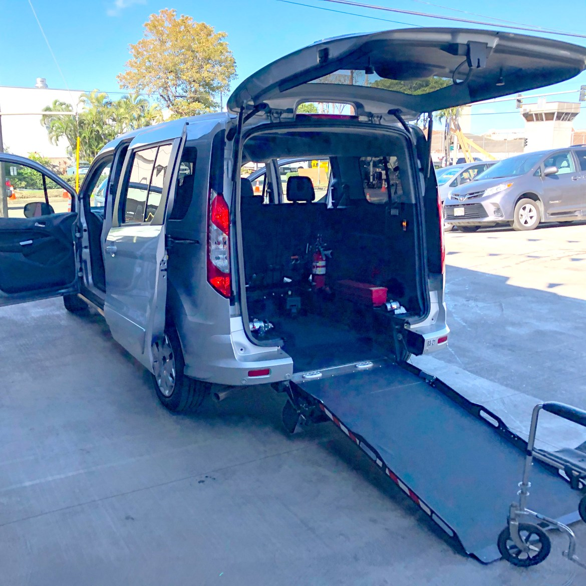 Driverge Ford Transit Connect with the rear-entry, manual ramp deployed